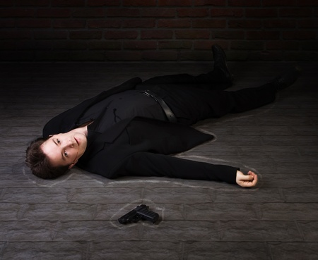 Corpse of business man lays on a floor   photo