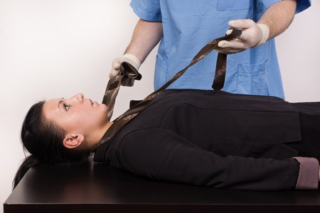 Coroner inspects the body of the crime victim  imitation Stock Photo - 12542308