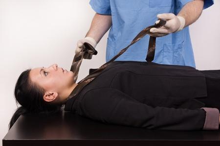 coroner: Coroner inspects the body of the crime victim  imitation
