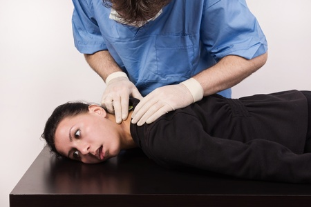 Coroner inspects the body of the crime victim  imitation Stock Photo - 12542450