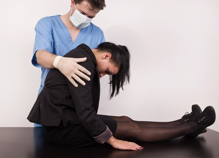 Coroner inspects the body of the crime victim (imitation) Stock Photo - 12896170