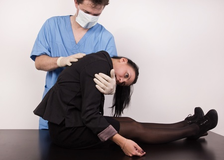 Coroner inspects the body of the crime victim (imitation) Stock Photo - 12880612