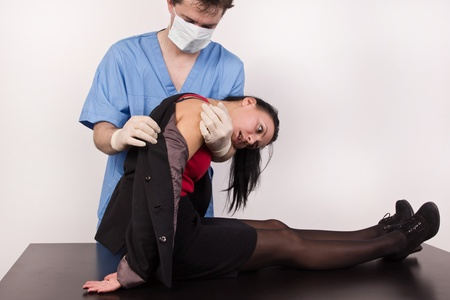 Coroner inspects the body of the crime victim (imitation) Stock Photo - 12896165