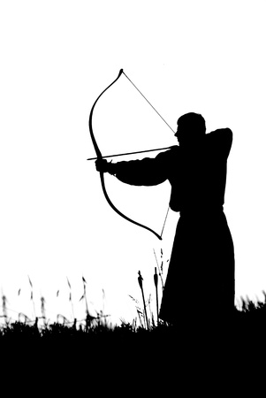 crossbow: Silhouette of a monk shooting of a long bow