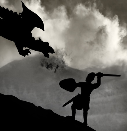 feudal: Silhouette of a medieval knight fighting the dragon