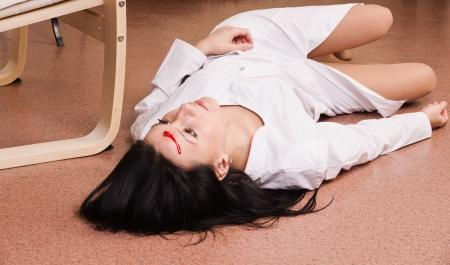 Crime scene imitation. Lifeless nurse lying on the floor Stock Photo - 13761640