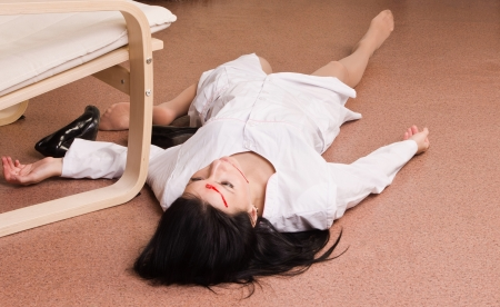 nursing staff: Crime scene imitation. Killed nurse lying on the floor Stock Photo