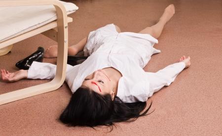 Crime scene imitation. Killed nurse lying on the floor Stock Photo - 13761651