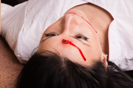 senseless: Crime scene imitation. Killed nurse lying on the floor Stock Photo