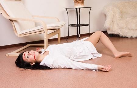 csi: Crime scene imitation. Lifeless nurse lying on the floor Stock Photo