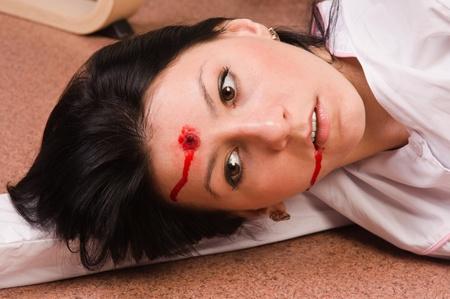 forensic medicine: Crime scene imitation. Lifeless nurse lying on the floor Stock Photo