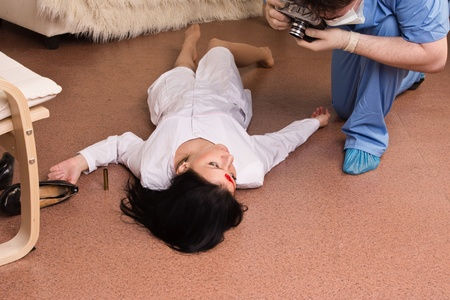 dirty bussines: Forensic expert collecting evidence in a crime scene (imitation) Stock Photo