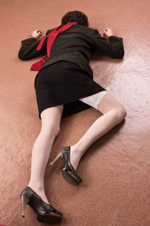 Crime scene imitation. Killed business woman lying on the floor Stock Photo - 13761678