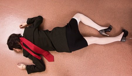 Crime scene imitation. Killed business woman lying on the floor Stock Photo - 13761680
