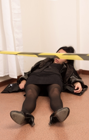 senseless: Crime scene imitation. Killed business woman lying on the floor