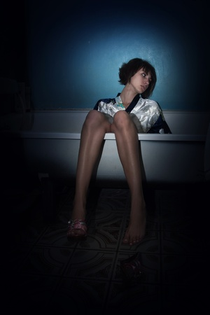 Crime scene simulation: lifeless  girl in a bathroom Stock Photo - 13761542