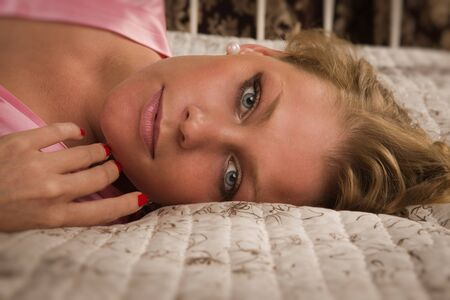 Portrait of the attractive blonde in a boudoir photo