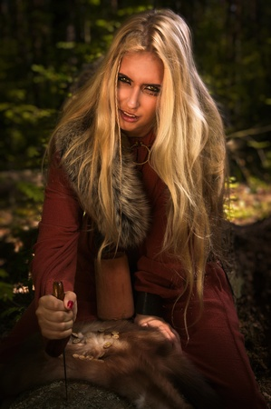 runes: Scandinavian witch pythoness with runes on a forest background