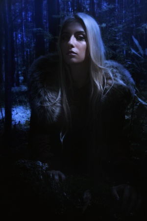northern european: Scandinavian girl in the night dark forest