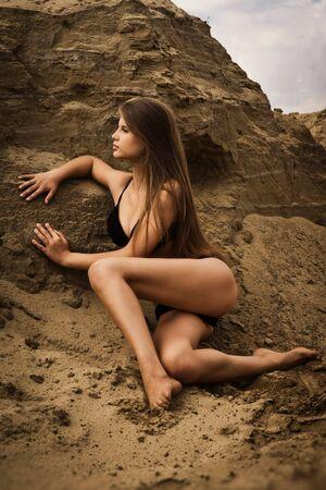 plage: Attractive girl in a bikini on a sandy beach