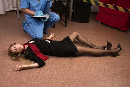 Forensic expert collecting evidence in a crime scene (imitation) Stock Photo - 15134758