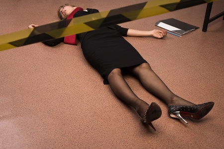 Crime scene imitation. Lifeless business woman lying on the floor photo