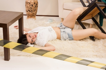 Crime scene imitation. Lifeless woman lying on the floor Stock Photo - 15276049