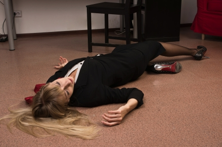 senseless: Crime scene imitation. Lifeless business woman lying on the floor   Stock Photo
