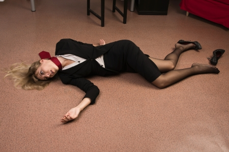 Crime scene imitation. Lifeless business woman lying on the floor Stock Photo - 15276089