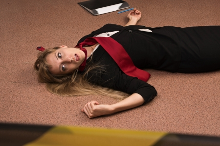 corpse: Crime scene imitation. Lifeless business woman lying on the floor