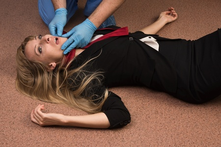 strangulation: Forensic expert collecting evidence in a crime scene (imitation) Stock Photo