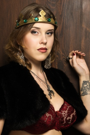 Portrait of the sexy woman wearing a crown in a medieval castle interior Stock Photo - 16382571