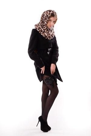 spy girl: Spy girl in a black coat with the gun