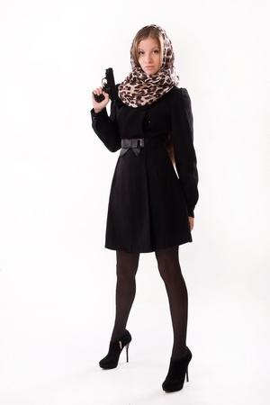 spy girl: Spy girl in a black coat with gun