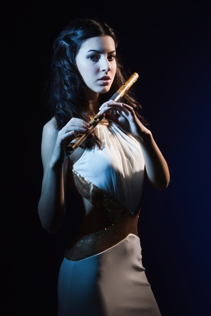 Sensuality beauty brunette with a wooden flute Stock Photo - 16382720