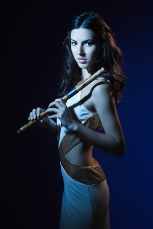Sensuality beauty brunette with a wooden flute Stock Photo - 16383132
