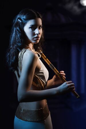 Sensuality beauty brunette with a wooden flute Stock Photo - 16383126