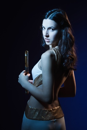 Sensuality beauty brunette with a wooden flute Stock Photo - 16383098