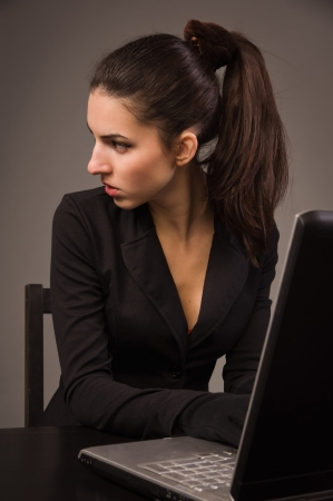 spy girl: Spy girl in a black suit with laptop