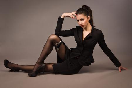 spy girl: Spy girl in a black suit with gun   Stock Photo