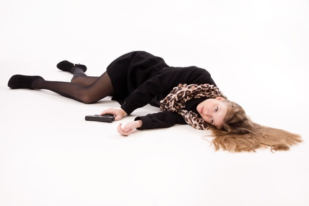 scene of a crime: Crime scene imitation. Spy girl with gun lying on the floor