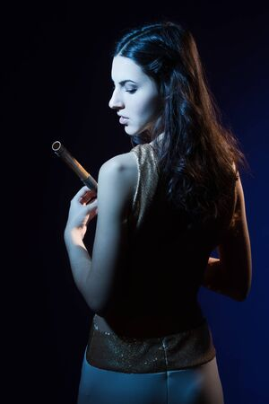 Sensuality beauty brunette with a wooden flute Stock Photo - 16382898