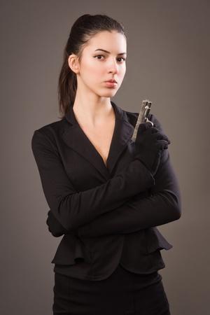 spy girl: Spy girl in a black suit with gun