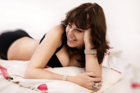 Portrait of the sexual brunette woman in the bedroom photo