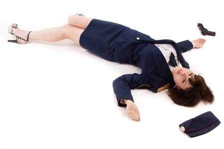 Crime scene imitation. Woman officer lying on a floor photo