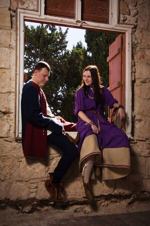 Couple in a medieval suit in a Agia Napa Medieval Monastery photo