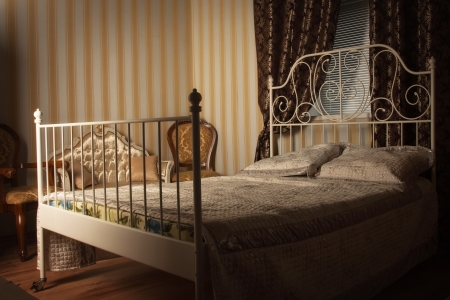 luxury bed: Old style bed in the elegant bedroom Stock Photo