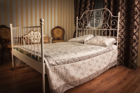 Old style bed in the elegant bedroom Stock Photo - 16884026