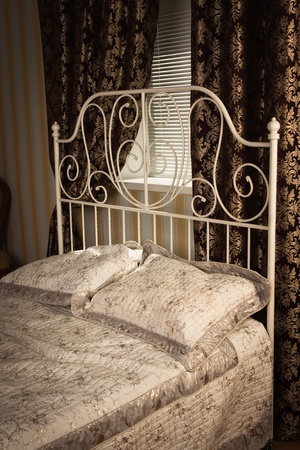 Old style bed in the elegant bedroom Stock Photo - 16884030