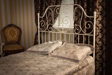 Old style bed in the elegant bedroom Stock Photo - 16884028